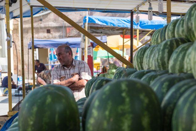 Melonen mit Verkäufer